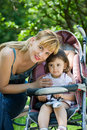 Free Mother With Baby Carriage Royalty Free Stock Photos - 19668578