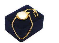 Black Box With Golden Watch Pocket Stock Image