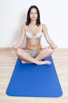 Woman Performing Yoga Exercise Royalty Free Stock Photo