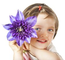 Free Little Girl With Clematis Flower Royalty Free Stock Images - 19663479