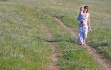 Mother And Child Walking By Road