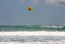 Free Parasailing Over Crashing Waves Royalty Free Stock Images - 19666489