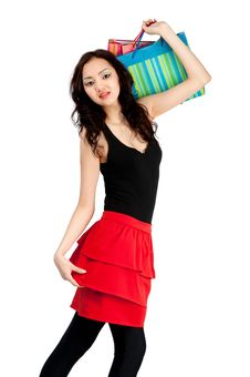 Asiatic Young Women With Shopping Bags, Isolated Stock Photo