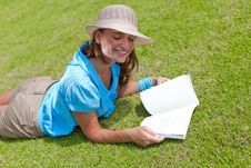 Woman On Grass With Open Book Royalty Free Stock Images