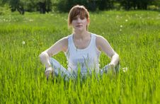 Free Girl In A Lotus Position In Park Royalty Free Stock Image - 19669176
