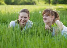 Free Happy Sisters Lying In  Grass Stock Photo - 19669240