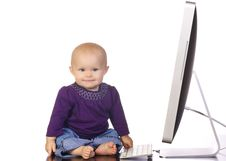 Free Infant Girl Typing On A Desktop Computer Royalty Free Stock Photos - 19671508