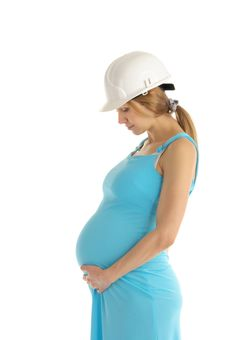 Pregnant Woman In Helmet Stock Photo