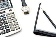 Free Calculator Note Pad And Watch Stock Photo - 19671960