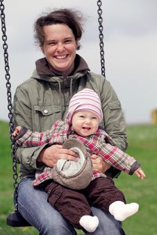 Free Smiling Baby Girl With Her Mom On A Swing Stock Photography - 19674602