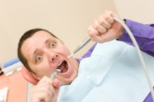 Scary Man Is Waiting In The Stomatology Place Stock Photo