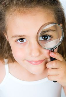 Free Little Girl Looking Through A Magnifying Glass Stock Photo - 19676490