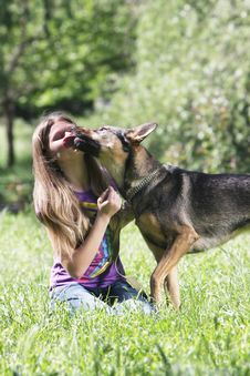 Girl With Dog Outdoors Stock Photo