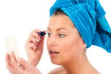 Free Young Woman Applying Makeup Royalty Free Stock Image - 19676656