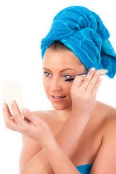 Free Young Woman Applying Makeup Stock Photography - 19676662