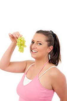 Free Young Woman Eating Grapes Stock Photography - 19676672