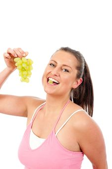 Free Young Woman Eating Grapes Royalty Free Stock Photography - 19676677
