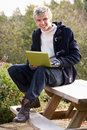 Free Young Man With Laptop Computer Royalty Free Stock Photography - 19689157
