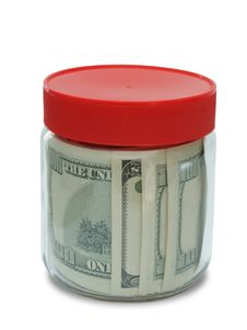 Banknote In Jar Royalty Free Stock Photography