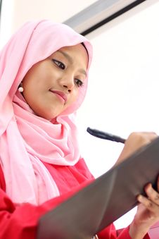 Free Muslim Girls Writing On Report File Stock Images - 19685324
