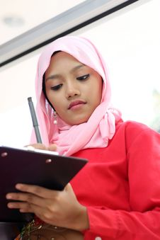 Free Muslim Girls Writing On Report File Stock Images - 19685374