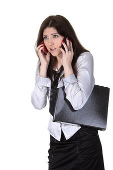 Angry Businesswoman Speak Two Phones Royalty Free Stock Photography