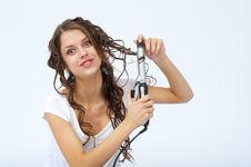 Free Pretty Girl Doing Her Hair Royalty Free Stock Image - 19687036