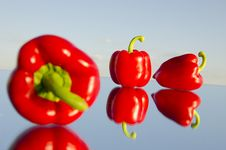 Free Three Red Peppers On Mirror Stock Photography - 19688062