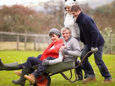 Free Two Young Couples Playing In Wheelbarrow Stock Photography - 19688272