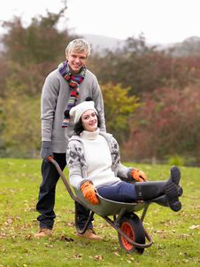Free Young Couple Playing In Wheelbarrow Stock Image - 19688321