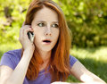 Free Surprised Redhead Girl With Mobile Phone Stock Image - 19695081