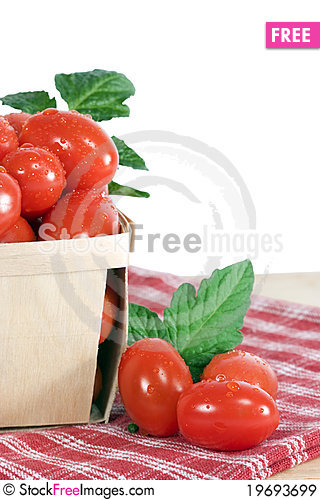 Free Grape Tomatoes In Wood Basket Royalty Free Stock Images - 19693699