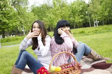 Free Mother And Daughter Talk On The Phone In The Park Stock Image - 19690191