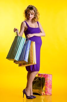 Free Pregnant Woman Looking Inside Shopping Bags Royalty Free Stock Photo - 19692125