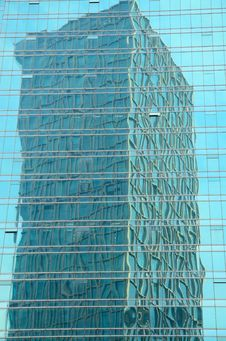 Free One Tower Mirrored In Another Building Royalty Free Stock Photography - 19693077