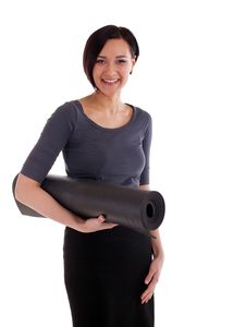 Free Yong Woman With Yoga Rubber Mat Stock Photos - 19693653