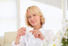 Free Portrait Of Young Lady With A Cup Stock Photo - 19693800