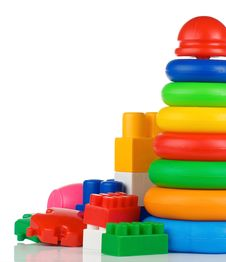 Free Colorful Plastic Toys And Bricks On White Royalty Free Stock Photo - 19694275