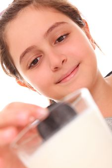 Girl Eating Cookies And Milk Royalty Free Stock Photos