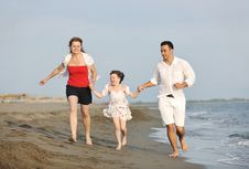 Happy Young Family Have Fun On Beach Royalty Free Stock Photography