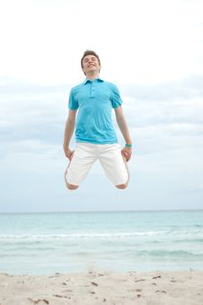Free Young Man Jumping On The Beach Royalty Free Stock Photo - 19699485