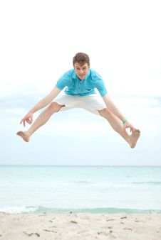 Free Young Man Jumping On The Beach Royalty Free Stock Images - 19699489