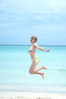 Free Young Woman Jumping On The Beach Stock Image - 19699561