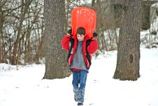 Free Boy Carrying Sled Stock Image - 1978391
