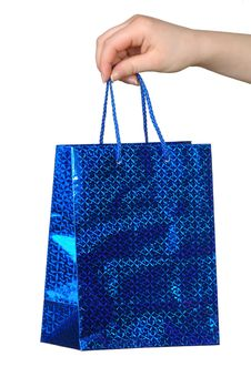 Blue Package With A Gift In A Hand On A White Background Stock Photography