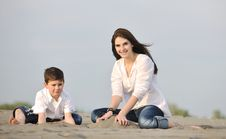 Free Mom And Son Relaxing On Beach Stock Image - 19700141