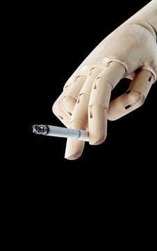 Wooden Hand With Cigarette Royalty Free Stock Images