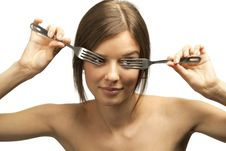 Female Looking Through Forks Royalty Free Stock Photos