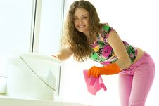 Free Girl Washing The Window Royalty Free Stock Image - 19703476