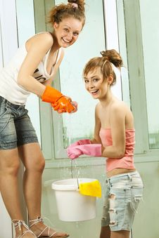 Free Girls Washing The Window Stock Image - 19703481